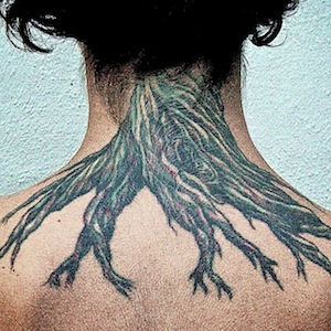 Woman with tree root tattoo