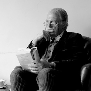 Older man with book, thinking