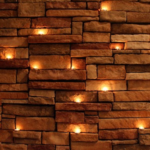 Tealights against brick wall